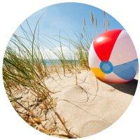 Beach ball in dune grass