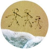 Stick figures drawn in beach sand