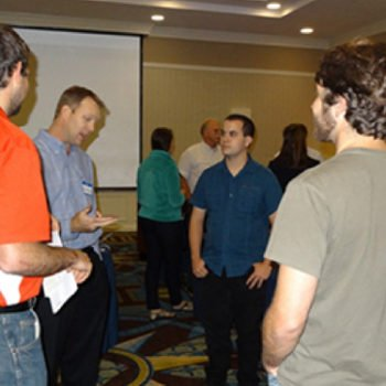 2014 Student Short Course: Professional Preparation. Above: Gordon Thomson (Director, CB&I) chatting with student short course attendees from University of Louisiana – Lafayette, Florida Atlantic University, and Virginia Institute of Marine Science (2014).