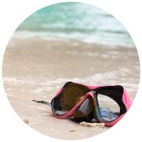 Goggles sitting on the beach