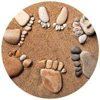 Rocks on beach arranged to look like feet